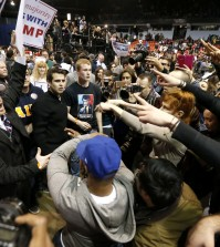 Supporters of Republican presidential candidate Donald Trump, left, face off with protesters after a rally on the campus of the University of Illinois-Chicago was cancelled due to security concerns Friday, March 11, 2016, in Chicago. (AP Photo/Charles Rex Arbogast)