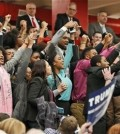 FILE -- Protesters yell as they are escorted out of a rally for Republican presidential candidate, Donald Trump at Radford University in Radford, Va., Monday, Feb. 29, 2016. (AP Photo/Steve Helber)