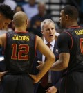 Southern California head coach Andy Enfield, second from right, speaks with forward Bennie Boatwright, left, guard Julian Jacobs, second from left, and Southern California forward Darion Clark during the second half of an NCAA college basketball game against Utah in the quarterfinal round of the Pac-12 men's tournament Thursday, March 10, 2016, in Las Vegas. Utah won 80-72. (AP Photo/John Locher)