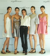 Victoria Beckham (C) stands with Korean models wearing her new clothing line for a photo after a press conference held in Seoul on March 21, 2016 to unveil new dresses exclusively designed for Asian customers and available on the mytheresa.com online shopping mall in this photo provided by mytheresa.com.