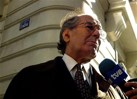 FILE - In this Feb. 21, 2005, file photo, Nobel Peace Prize winner Adolfo Perez Esquivel answers a journalist's questions at the Spanish National Court in Madrid, Spain, where he testified in a trial against an ex-Argentine navy officer Alfredo Scillingo accused of genocide committed in his country's dirty war more than two decades ago. Perez Esquivel said on Wednesday, March 2, 2016, that President Barack Obama should skip his planned March 24 visit to the country because it's the 40th anniversary of a coup that installed a military government that had U.S. backing. (AP/Mariana Eliano, File)