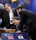 South Korean professional Go player Lee Sedol smiles as he reviews the match with other Go players after finishing the final match of the Google DeepMind Challenge Match against Google's artificial intelligence program, AlphaGo, in Seoul, South Korea, Tuesday, March 15, 2016. Google's Go-playing computer program again defeated its human opponent in the final match on Tuesday that sealed its 4:1 victory. (AP Photo/Lee Jin-man)