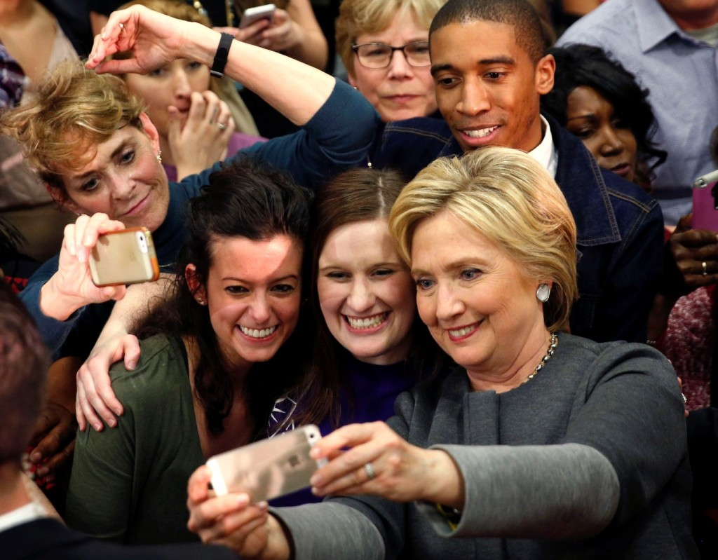 Democratic presidential candidate Hillary Clinton takes photos with supporters after speaking at a campaign rally in Norfolk, Va., Monday, Feb. 29, 2016. (AP Photo/Gerald Herbert)