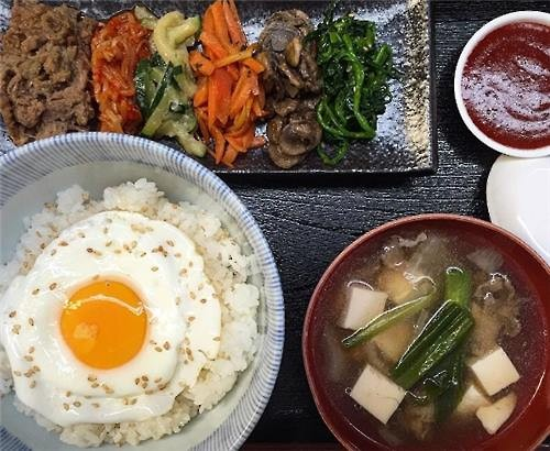 Lunch at Danji. Bulgogi bibimbap with Korean radish soup. (Courtesy of Hooni Kim)