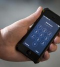 FILE - This Feb. 17, 2016 file photos an iPhone is seen in Washington. The dispute over whether Apple must help the FBI hack into a terror suspect's iPhone is about to play out in a Southern California courtroom. The hearing Tuesday, March 22, in U.S. District Court in Riverside is the first in the battle that has seen Cook and FBI Director James Comey spar over issues of privacy and national security. (AP Photo/Carolyn Kaster,File)