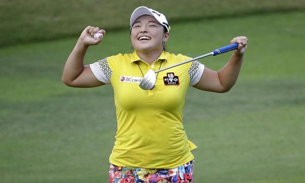 ang Ha Na of South Korea celebrates after winning the HSBC Women's Champions Golf tournament on Sunday, March 6, 2016, in Singapore. (AP Photo/Wong Maye-E)