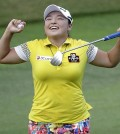 ang Ha Na of South Korea celebrates after winning the HSBC Women's Champions Golf tournament on Sunday, March 6, 2016, in Singapore. (AP Photo/Wong Maye-E)