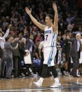 Charlotte Hornets' Jeremy Lin celebrates after an NBA basketball game against the San Antonio Spurs in Charlotte, N.C., Monday, March 21, 2016. The Hornets won 91-88. (AP Photo/Chuck Burton)