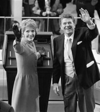 FILE - In this Jan. 20, 1981, file photo, President Ronald Reagan and first lady Nancy Reagan wave to onlookers at the Capitol building as they stand at the podium in Washington following the swearing in ceremony. The former first lady has died at 94, The Associated Press confirmed Sunday, March 6, 2016. (AP Photo/File)