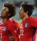 South Korean Olympic football team midfielder Moon Chang-jin (L) celebrates with teammate Kwon Chang-hoon after scoring a goal against Algeria during their friendly match at Icheon Sports Complex in Icheon, Gyeonggi Province, on March 25, 2016. (Yonhap