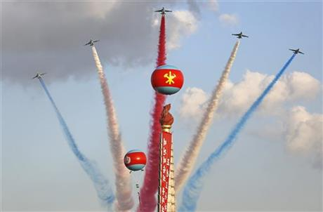 In this Saturday, Oct. 10, 2015, photo, jets fly over the Juche Tower during a parade on the Kim Il Sung Square in Pyongyang, North Korea. North Korea hasn't acquired any new fighter aircraft for decades. Its best fighters are 1980s era MiG-29s bought from the Soviet Union, the MiG-23 and SU-25 ground attack aircraft. (AP Photo/Wong Maye-E)