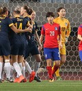 Members of the Australian football team celebrate after scoring their first goal in the 56th second against South Korea during the Asian women's Olympic football qualifying match at Yanmar Stadium Nagai in Osaka, Japan, Friday. (Yonhap)