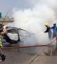 ire fighters extinguish a burning car that was slammed into by a black Mercedes killing it's two occupants on a Thai highway on March 13, 2016. The smaller car burst into flames and the couple inside, both graduate students in their 30s, died at the scene of the accident. (Senior Sergeant Major Parichart Pangrith via AP)