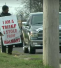 "A judge gave this man  sentencing option of 30 days in jail or wearing a sign saying, ""I am a thief. I stole from WalMart."" He chose to wear the sign in front of the store eight hours a day for 10 days. (WKBN news screen capture)"