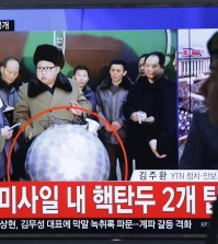 "A South Korean army soldier passes by a TV news program showing North Korean leader Kim Jong Un, at Seoul Railway Station in Seoul, South Korea, Wednesday, March 9, 2016. The official North Korean news agency says the communist country's leader Kim his nuclear scientists for a briefing and declared he was greatly pleased that warheads had been miniaturized for use on ballistic missiles. The letters at the screen read ""North Korea' nuclear warhead "". (AP Photo/Ahn Young-joon)"