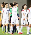 South Korean Olympic women's football team members look dejected as they leave the pitch after their 0-1 loss to China in Asian qualifying tournament at Nagai Stadium in Osaka, Japan, Monday. (Yonhap)