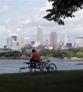 In this July 8, 2014, file photo, a man sits on a picnic table with a view of downtown Cleveland. Forty-two rules govern the Republican Party and how it picks a presidential candidate. Yet with the nomination potentially up for grabs at July's GOP convention, one reality prevails: Delegates can change their procedures to help or hurt any candidate they want.