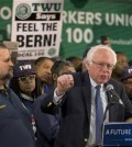 TWU Local 100 President John Samuelsen listens at left as Democratic presidential candidate, Sen. Bernie Sanders, I-Vt. speaks after being endorsed by TWU Local 100, Wednesday, April 13, 2016, in the Brooklyn borough of New York.