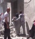 This image made from video released by Qasion News Agency, a media opposition platform that relies on a network of activists on the ground, on Friday, April 29, 2016 shows people scrambling through rubble following airstrikes in Aleppo, Syria. Insurgents shelled a mosque in a government-held neighborhood of Aleppo, killing at least 15 people as they left Friday prayers, while government airstrikes struck rebel-held parts of Syria's largest city — even as the army unilaterally declared a brief truce in other parts of the country.