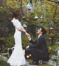 A wedding photo of actress Park Soo-jin and actor Bae Yong-joon.