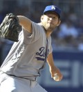 Los Angeles Dodgers starting pitcher Clayton Kershaw works against the San Diego Padres during the first inning of a baseball game Monday, April 4, 2016, in San Diego.