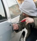 man-breaking-into-car-door