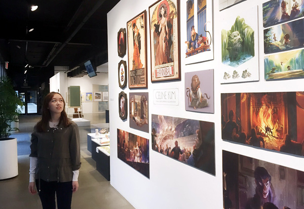 Celine Kim inspects her solo exhibition inside Art Center College of Design, where she graduated with distinction.