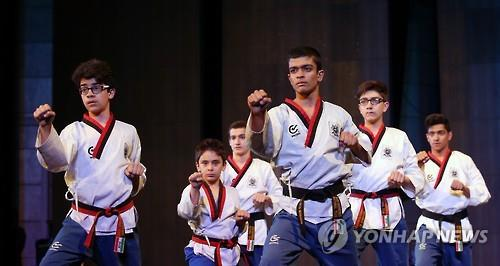 """Taekwondo players perform during the """"Korea Culture Week"""" at the Milad Tower in Tehran, Iran, on May 2, 2016. (Yonhap)"""