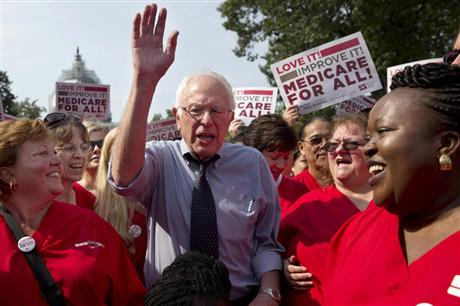 In this July 30, 2015 file photo, Democratic presidential candidate, Sen. Bernie Sanders, I-Vt., waves after speaking at a rally with registered nurses and other community leaders celebrate the 50th anniversary of Medicare and Medicaid, on Capitol Hill Washington.