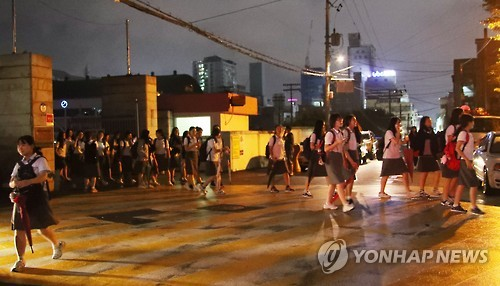 Students evacuate from a school in the southern city of Ulsan on Sept. 12, 2016