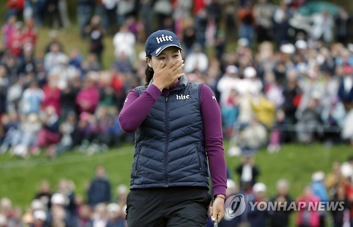 In this Associated Press photo, Chun In-gee of South Korea reacts to her victory at the Evian Championship on the LPGA Tour in Evian-les-Bains, France, on Sept. 18, 2016.