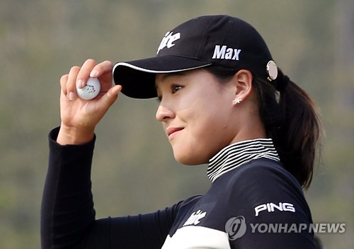 In this file photo taken on Oct. 14, 2016, South Korean golfer Chun In-gee shows her respect to fans during the second round of the LPGA KEB HanaBank Championship at Sky72 Golf Club in Incheon.