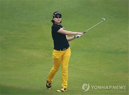 In this file photo provided by the Korea LPGA Tour, Lee Jeong-eun hits a shot during the second round of the E1 Charity Open at South Springs Country Club in Icheon, Gyeonggi Province, on June 1, 2013.