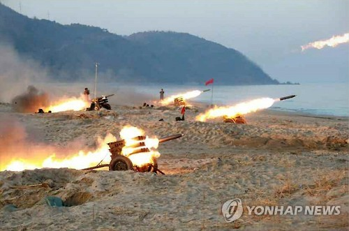 North Korean leader Kim Jong-un observes a firing contest by multiple launch rocket system (MLRS) batteries in this photo unveiled by the Rodong Sinmun, North Korea's main newspaper on Dec. 21, 2016. (For Use Only in the Republic of Korea. No Redistribution)
