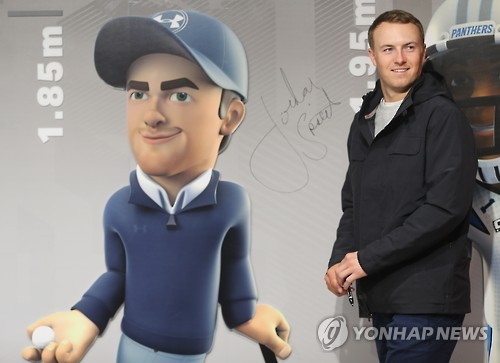 Jordan Spieth, the world No. 5 in men's golf, poses next to his caricature at the Under Armour store in Seoul on Jan. 19, 2017.
