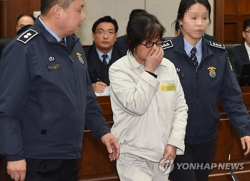 "Choi Soon-sil, dubbed South Korea's ""Rasputin,"" enters a Seoul courtroom on Jan. 5, 2017, to attend the first formal court hearing on a massive influence-peddling scandal that has led to President Park Geun-hye's impeachment. Choi, 60, is charged with abuse of power and attempted fraud. (pool photo)"