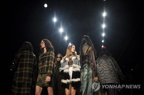 Models present creations during the Concept Korea fall 2016 show at the New York Fall Fashion Week in New York on Feb. 12, 2016.