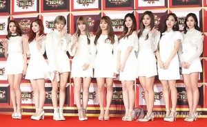 Girl group TWICE poses for photos at the 2016 KBS Music Festival in Seoul on Dec. 29, 2016.