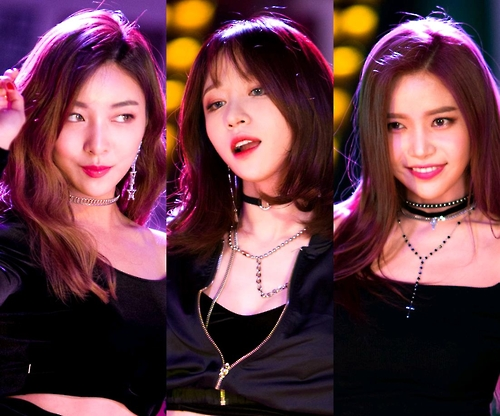 This image, provided by Mystic Entertainment, shows South Korean girl group members Luna of f(x), Hani of EXID and Solar of Mamamoo (L to R).