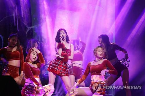 "Seohyun (C) of Girls' Generation showcases her new song ""Don't Say No"" at a media event in Seoul on Jan. 16, 2017."