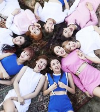 The file photo, provided by JYP Entertainment, shows members of K-pop group TWICE.