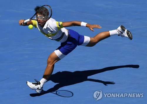 In this Associated Press photo, South Korea's Chung Hyeon hits a shot against Grigor Dimitrov of Bulgaria during their second-round match at the Australian Open at Hisense Arena in Melbourne on Jan. 19, 2017.
