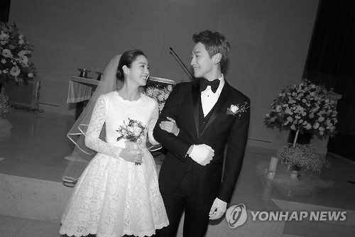 In this photo provided by the Rain Company, singer-actor Rain and actress Kim Tae-hee smile during their wedding at Gahoe-dong Church in central Seoul on Jan. 19, 2017.