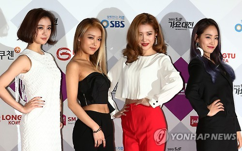 In this file photo taken on Dec. 17, 2015, Wonder Girls members Hyerim, Yubin, Sunmi and Yeeun (from L) pose for a photo at a local music show in Seoul.