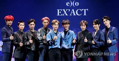 "In this file photo, South Korean boy group EXO poses for the camera during a showcase to promote the release of its third album ""EX'ACT"" in Seoul on June 8, 2016."