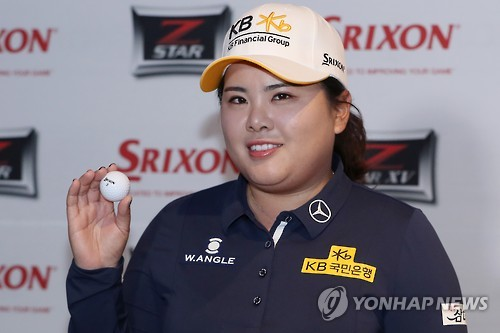 South Korean LPGA golfer Park In-bee holds up a ball during a corporate event in Seoul on Feb. 7, 2017.