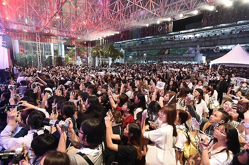 This image provided by S.M. Entertainment shows fans of the boy group NCT gathering at a promotional event for Masita seaweed snack at Siam Paragon in Bangkok on Feb. 7, 2017.