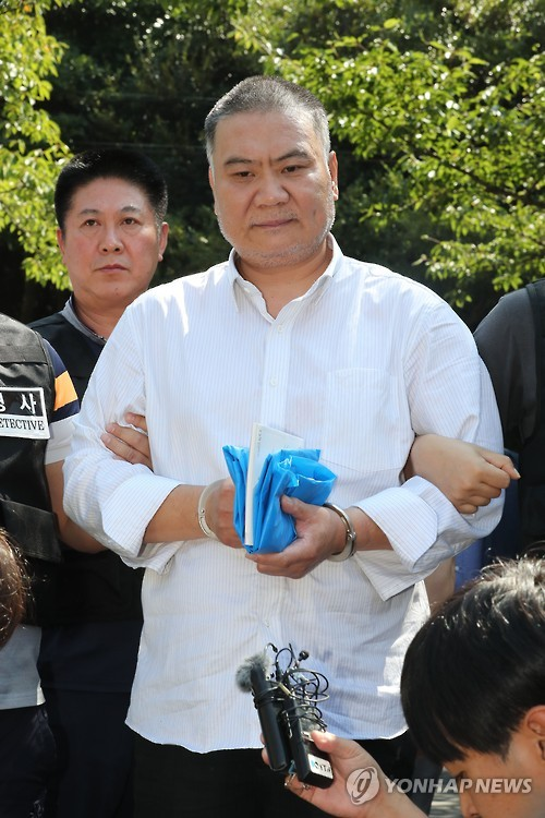 This file photo taken on Sept. 22, 2016, shows Chinese murder suspect Chen Guorui speaking to reporters after reenacting his crime in the city of Jeju on South Korea's largest island of Jeju.