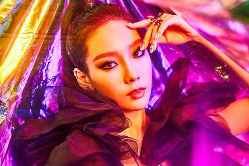 "This image provided by S.M. Entertainment shows a still from Taeyeon's upcoming ""I Got Love"" music video."