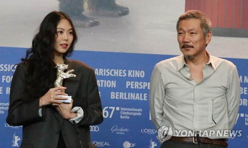 "Actress Kim Min-hee (L) and director Hong Sang-soo of ""On the Beach at Night Alone"" pose for a photo during a news conference at the 67th Berlin International Film Festival on Feb. 18, 2017. Kim won the festival's Silver Bear for Best Actress for the film."